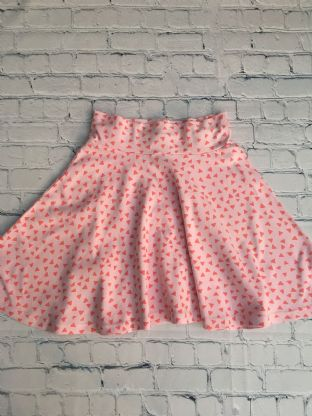 Joules light pink skirt with dark pink triangles age 9-10